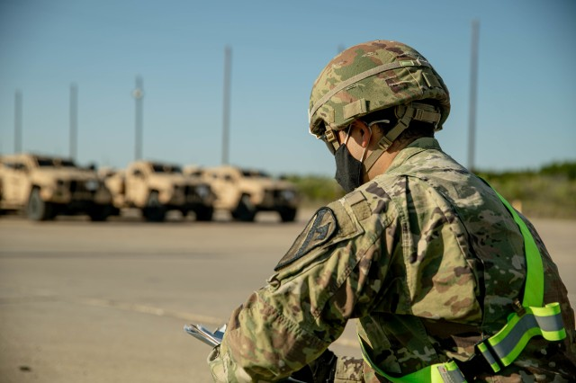2nd Lt. Brandon Garcia, 3rd Battalion, 8th Cavalry Regiment, 3rd Armored Brigade Combat Team (3ABCT), 1st Cavalry Division, take count of newly received Joint Light Tactical Vehicles (JLTVs) at the rail operations center, Fort Hood, Texas, Oct. 02, 2020. The JLTV is set to partly replace a portion of within 3ABCT. With modernization comes significant enhancements such as a bigger payload, better occupant survivability, and even an all-terrain suspension system. (U.S. Army photo taken by Sgt. Calab Franklin)