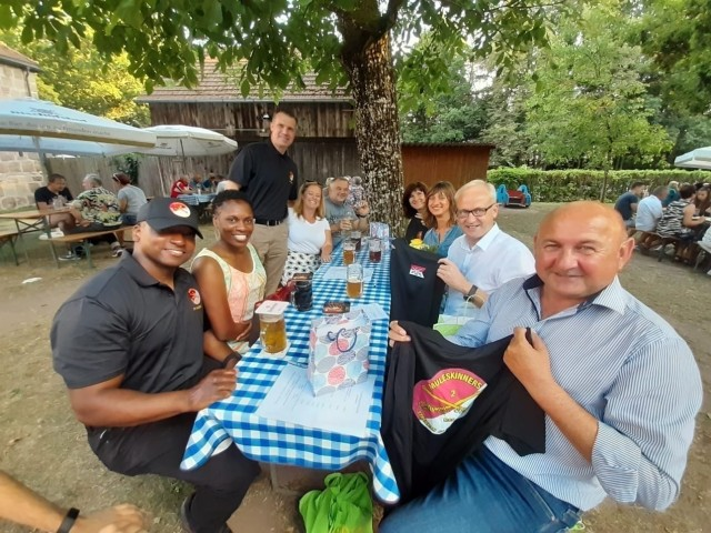 The leaders of the Regimental Support Squadron, 2d Cavalry Regiment, and its partner town of Hahnbach, Germany, exchange gifts at the Frohnberg restaurant Aug. 12, 2020. Their meeting marked the first event between RSS and Hahnbach since the squadron's change of command ceremony in Vilseck, Germany, July 20, 2020.
