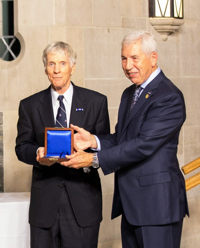 U.S. Ambassador Ryan C. Crocker (center) receives the Thayer Award Medal from the Chairman of the Board of Directors of the West Point Association of Graduates, Joseph E. DeFrancisco.