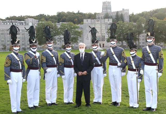 """U.S. Ambassador Ryan C. Crocker gets with the Brigade Staff following the Thayer Award Parade to do a """"Go Army, Beat Navy,"""" video Oct. 1 on The Plain."""