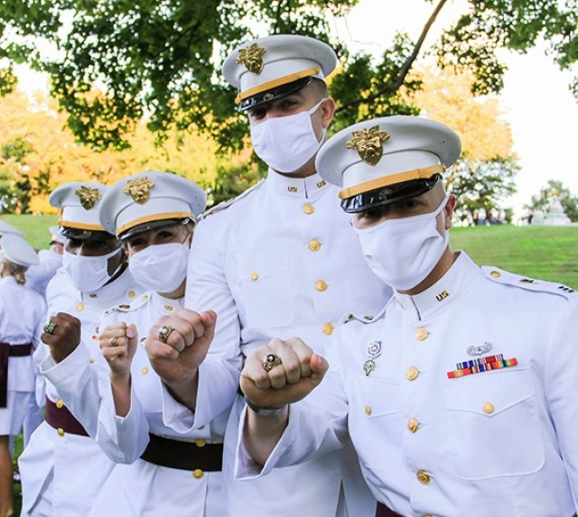 Cadets from the Class of 2021 show off their rings after receiving them during the Ring Ceremony Friday at Trophy Point.