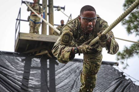 Tuskegee University Army ROTC cadet navigates a rope obstacle during training at Fort Benning, Ga., Sept. 19, 2020.