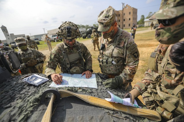 Col. Robert Born, commander of 1st Brigade Combat Team, 101st Airborne Division (Air Assault), briefs Maj. Gen. Brian E. Winski, commanding general of the 101st Abn. Div. and Fort Campbell, on his defensive plan via a map on the hood of a humvee after a press conference Sept. 19 during operations at Joint Readiness Training Center-Fort Polk, Louisiana. Bastogne Soldiers conducted a month long training exercise at JRTC-Fort Polk. (U.S. Army photo by Staff Sgt. Justin Moeller)