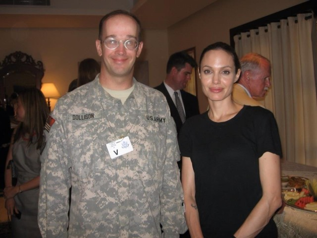 Due to his work in support of refugees, Dollison meets Angelina Jolie while stationed in Baghdad.