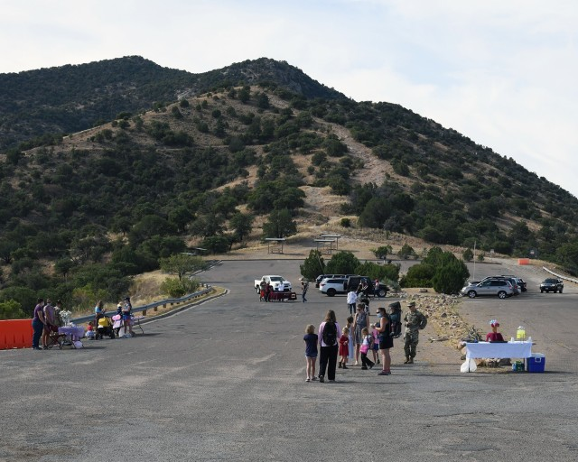 """Attendees of the Pregnancy and Infant Loss Awareness event on Ft. Huachuca take part in a """"Walk to Remember"""" which provided them the chance to participate in activities and receive various resources to help in their grieving processes to include: flyers, prayer cards, painting rocks, blowing bubbles and receiving counseling and stress management tips."""