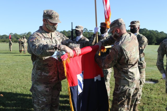 Col. Trent Upton, commander, and Command Sgt. Major Jonathan Reffeor, senior enlisted leader, 1st Armored Brigade Combat Team prepare to case the brigade colors during the unit's color casing ceremony at Cottrell Field in Fort Stewart, Georgia, Oct. 1, 2020. The 1st ABCT will replace the 2nd Brigade Combat Team, 1st Infantry Division, as part of a regular rotation of forces to support the United States' commitment to Southeast Asia partners and allies. The casing of the colors is a traditional ceremony held by United States Army commands, brigades and regiments. It is customary for the unit's flag, or its colors, to be properly stored prior to the unit's deployment. (U.S. Army photo by Sgt. Reva Catholic)