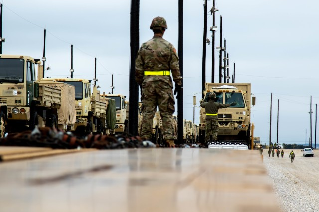 1st Cavalry Division Sustainment begins to load vehicles during rail-load operations at Fort Hood, Texas, Jan. 30, 2020. The rail-load operations are in preparation of exercise Defender-Europe 20, the deployment of a division-size combat-credible force from the United States to Europe.