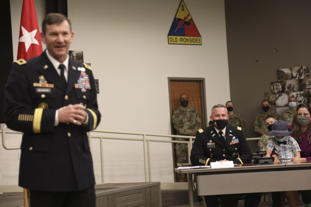 Maj. Gen. John B. Richardson IV, Deputy Commanding General, III Corps and Fort Hood, provides remarks prior to promoting Lt. Col. Bryan W. Frizzelle to the rank of Colonel in a ceremony held at 1st Armored Division Headquarters at Fort Bliss, Texas Oct. 16. Frizzelle is one of 14 Lieutenant Colonels from across the U.S. Army selected to serve in a higher grade in a new Army Talent Management program being implemented globally. Richardson was a Cadre member at the U.S. Military Academy at West Point, N.Y. when Frizzelle was a Cadet over 20 years ago. (U.S. Army photo by Staff Sgt. Nicholas Brown-Bell)