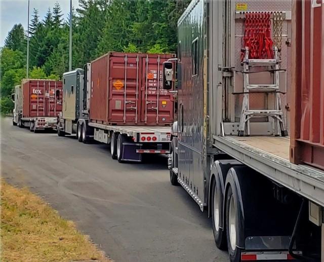 Trucks convoy to Naval Magazine Indian Island from transition yard at Kitsap Bangor.