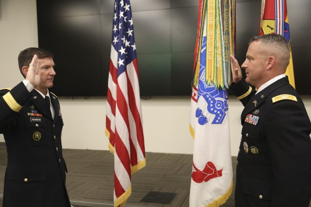Maj. Gen. John B. Richardson IV, Deputy Commanding General, III Corps and Fort Hood, administers the oath of office to Lt. Col. Bryan W. Frizzelle to finalize his promotion to Colonel in a special ceremony held at 1st Armored Division Headquarters Oct. 16. Frizzelle is one of 14 Lieutenant Colonels from across the U.S. Army selected to serve in a higher grade in a new Army Talent Management program being implemented globally under the brevet program. Frizzelle currently serves as the 1AD G3 Operations Chief. Richardson served as a Cadre member at the U.S. Military Academy at West Point when Frizzelle was a Cadet over 20 years ago. (U.S. Army photo by Staff Sgt. Nicholas Brown-Bell)
