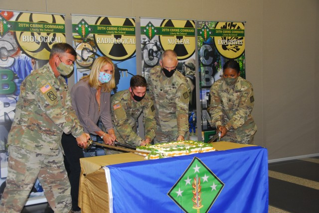 From Left to Right- Brig. Gen. Andy Munera, Pamela Silcox, Spc. Dale Felker, Lt. Col. Jeffery Wilson and Command Sgt, Maj. Henney Hodgkins participate in the traditional cutting of the cake during the 20th CBRNE 16th Anniversary celebration Oct. 16.
