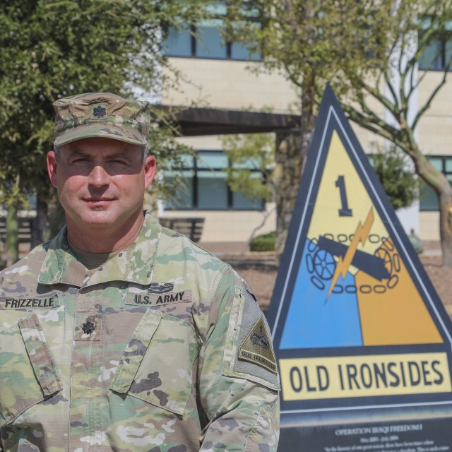 Lt. Col. Bryan W. Frizzelle poses outside 1st Armored Division Headquarters prior to his promotion ceremony Oct. 16. Frizzelle is one of 14 Lieutenant Colonels from across the U.S. Army selected to serve in a higher grade in a new Army Talent Management program being implemented globally under the brevet program. Frizzelle currently serves as the 1AD G3 Operations Chief. Maj. Gen. John B. Richardson IV, III Corps and Fort Hood Deputy Commanding General, promoted Frizzelle to the rank of Colonel in a special ceremony at 1AD Headquarters Oct. 16. Richardson served as a Cadre member at the U.S. Military Academy at West Point when Frizzelle was a Cadet over 20 years ago. (U.S. Army photo by Staff Sgt. Nicholas Brown-Bell)