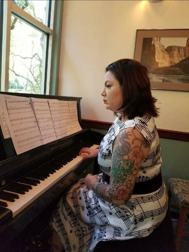 Brandy Sloan playing the piano.