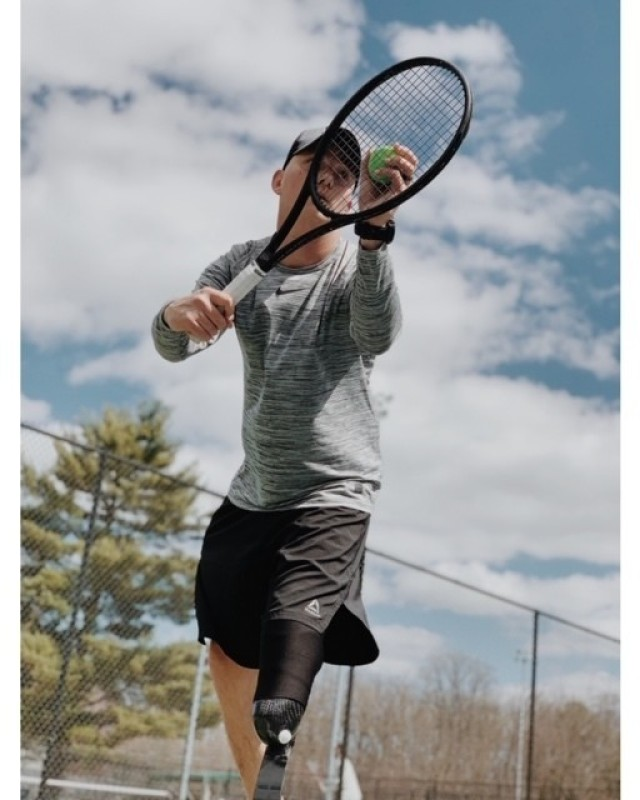 Participants in the tennis program used by the Walter Reed SRU learn skills at an outdoor facility in Gaithersburg, Maryland. (Photo credit: Karl Lee)