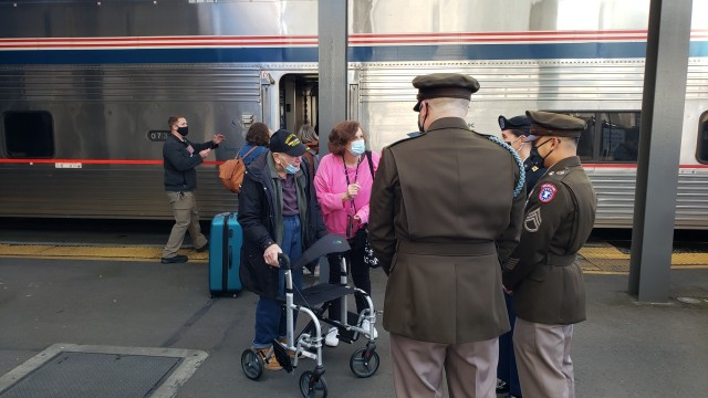 Recruiters with the Seattle Army Recruiting Battalion greet WWII and Army veteran James Edward Reed and his daughter Marybeth Reed, as they arrive at the King Street Station, Seattle, Oct. 15, 2020. The journey marked a milestone for Reed, who always desired to travel aboard the Empire Builder (Amtrak) train from St. Paul/Minneapolis to Seattle.