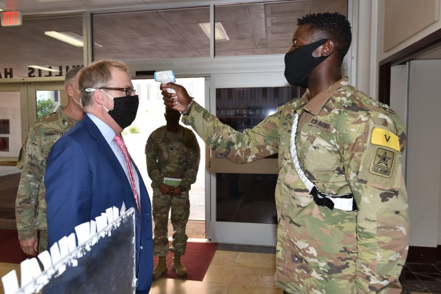 Thomas McCaffery, Assistant Secretary of Defense for Health Affairs, has his temperature checked while entering Willis Hall on his visit to the U.S. Army Medical Center of Excellence.