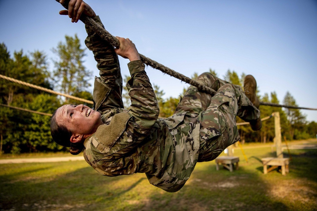 Army Spc. Catherine Downes moves through an obstacle during the 2020 U.S. Army Reserve Best Warrior Competition at Fort McCoy, Wis., Sept. 5, 2020.