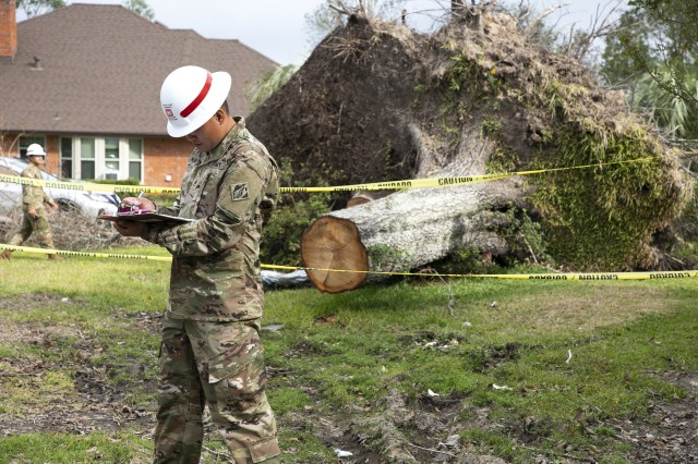 Soldiers from the 249th Engineer Battalion, Fort Bragg, N.C., are supporting the U.S. Army Corps of Engineers assessment of damaged homes, Oct 19. 2020,  after Hurricane Laura devastated the area in Calcasieu Parish. Hurricane Delta hit the area once again weeks later adding to the destruction Laura left behind. Staff Sgt. Pho Nguyen, 249th Engineer Battalion, conducts an assessment on the roof of a home. The tree behind him landed on the roof during Hurricane Delta. Just a few weeks before, the team assessed the same home which sustained damage during Hurricane Laura.