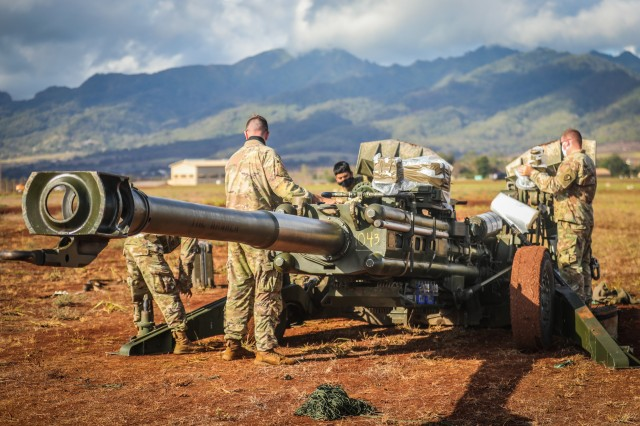 SCHOFIELD BARRACKS, Hawaii - Soldiers with Charlie Battery, 3rd Battalion, 7th Field Artillery Regiment, 3rd Brigade Combat Team, 25th Infantry Division prepare the M777 Howitzer for a sling load operation in preparation for a capabilities demonstration with Lt. Gen. S K Saini, Vice Chief of the Army Staff of the Indian Army on Schofield Barracks East Range, Hawaii, on Oct. 19, 2020. This visit will enhance the operational and strategic level collaboration between the two armies and builds towards a free and open USINDOPACOM.