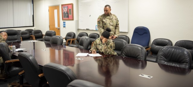 During the 13th ESC CCOY competition, Master Sgt. Opheline Moore, the 13th ESC Senior Retention Operations NCO, watches as the competitors take their written exam.  Career counselors from the 13th Expeditionary Sustainment Command and 1st Medical Brigade participated in the Career Counselor of the Year competition Oct. 15-16.