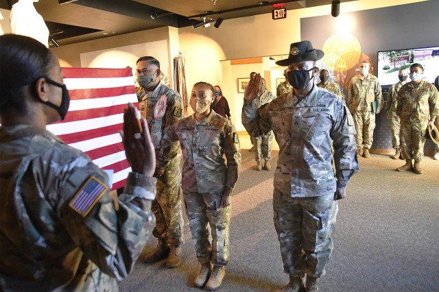 Col. Clydea M. Prichard-Brown, commander, 59th Ordnance Brigade, administers the oath of re-enlistment to Staff Sgt. Robin C. Stubbs and wife Sgt. Malaysia M. Stubbs during a dual enlistment ceremony Oct. 19 at the Army Women's Museum. SSG Stubbs is a career counselor assigned to Headquarters and Headquarters Company, 59th Ord. Bde. Sgt. Stubbs is a Delta Co., 832nd Ord. Battalion drill sergeant.