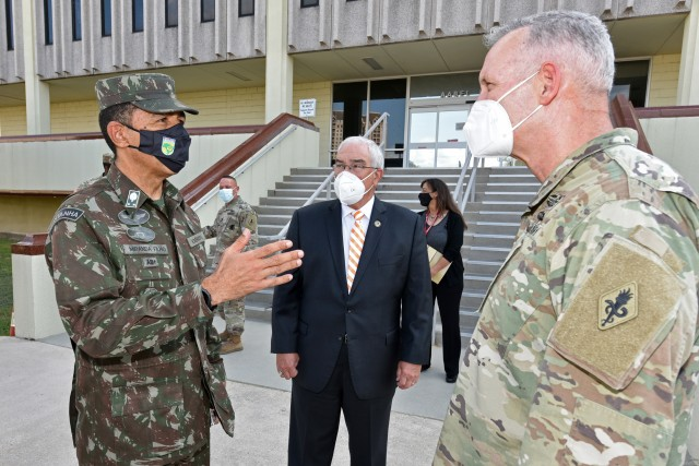 Maj Gen Miranda Filho, Mr. J.M. Harmon III, and Maj. Gen. Dennis LeMaster discus future education and training opportunities between the two countries during the Brazilian delegation visit.