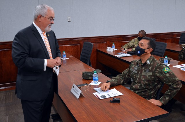 Mr. J.M. Harmon III provides Maj Gen Miranda Filho a briefing on the MEDCoE and future education and training opportunities between the two countries. Photo by Mike Gray, MEDCoE.