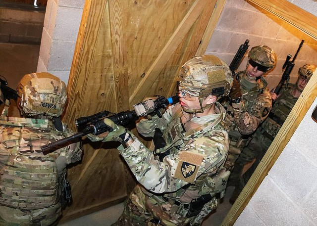Cadets execute their close quarters strategy in the target building at the Aachen training area Oct. 11. Virtual reality rehearsal allowed the cadets to effectively modify their strategy when casing the building. It also allowed them to have a better intuitive understanding of the layout and increased spatial awareness of the building.
