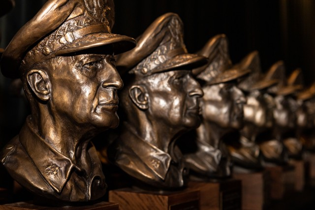A line of Gen. Douglas MacArthur leadership awards sit on a table before the ceremony Oct. 21, 2020, at the Pentagon, Washington, D.C.