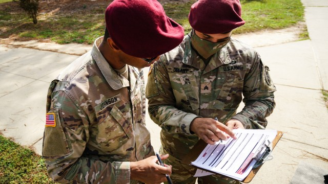Sgt. Hubert D. Delany, right, a public affairs mass communication specialist assigned to the 3rd Psychological Operations Battalion (Airborne) (Dissemination), helps a fellow Soldier register to vote through the Federal Voting Assistance Program as part of a voting registration drive at Fort Bragg, N.C., on October 13, 2020. The Federal Voting Assistance Program is a non-partisan government program administered by the Defense Department, designed to provide information, resources and tools to make voting easier for troops and family members living at home or abroad.(U.S. Army photo by Sgt. Liem Huynh)