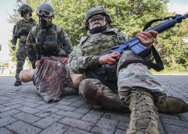 U.S. Army Lt. Col. Mark Lund, provides security during the Tactical Field Care (TFC) portion of the International Trauma Combat Casualty Care course at Landstuhl Regional Medical Center, Oct. 2. The international course, which included Service Members from four Nations, was aimed at providing unit-level health care providers life-saving instruction to increase survivability at the point of injury.