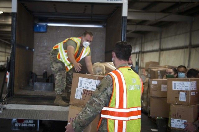 Soldiers and Airmen from the Connecticut National Guard load boxes of face masks into a vehicle at West Hartford Public Works, West Hartford, Conn., Sept. 30, 2020. The Connecticut National Guard is helping the state Department of Education and Division of Emergency Management and Homeland Security distribute 600,000 masks to school districts throughout the state.