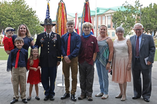 Col. Kevin Black, director of training and operations for 3rd Infantry Division, is joined by his family for a photo following his promotion ceremony on Oct. 23, 2020, at Fort Stewart, Georgia. Black promoted through the Brevet Promotion Program, which is intended to alleviate critical shortages of officers to better leverage the talents of junior officers, and to incentivize retention of officers whom the Army has trained and educated.  (U.S. Army photo by Sgt. Zoe Garbarino)