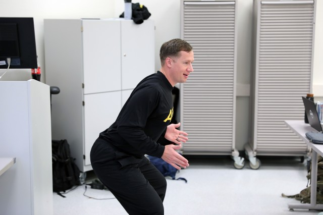 Capt. Daniel Huffman, a physical therapist at Landstuhl Regional Medical Center, demonstrates proper squat technique during a physical readiness training leadership course.