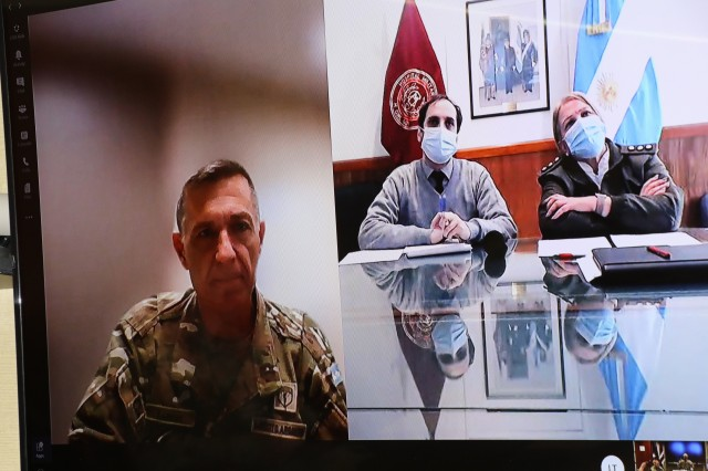 Argentine Army Col. Oscar Zarich, Argentine Partner Nation Liaison Officer, U.S. Army South, left, moderates a COVID-19 subject matter expert exchange between doctors from the Argentine Army and Brooke Army Medical Center, Oct. 21, 2020. The video teleconference consisted of a panel of medical professionals discussing lessons learned to provide a compilation of best practices in response to the COVID-19 pandemic and other health-related topics. (U.S. Army photo by Robert A. Whetstone)