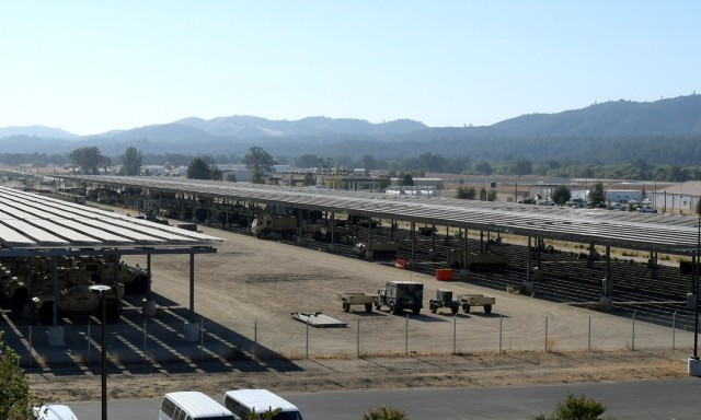 The Fort Hunter Liggett solar panels serves a dual function to produce energy and provide shade for equipment.