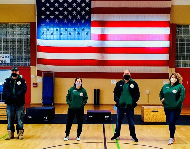 From L to R, Baumholder CYS Sports Program Equipment and Facilities Assistant Randy Ault, Fitness Specialist Andhia Campos, Director Marcel Fisher, and Assistant Director Whitney Clemmons. (Photo courtesy of Baumholder CYS.)