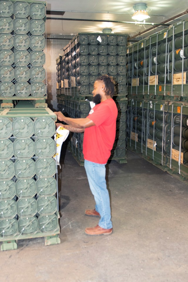 Jermaine Blaylock prepares a shipment of munitions at the Anniston Munitions Center. ANMC's mission is to provide accurate receipt, storage, issue and demilitarization of conventional ammunition and missiles in support of American's joint warfighters.