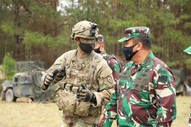 Col. Neal Mayo, commander of 2nd Brigade, 25th Infantry Division, discusses the importance of maintaining a partnership with the Indonesian Army with its Vice Chief of Staff Lt. Gen. Moch Fachrudin during an exercise at the Joint Readiness Training Center at Fort Polk, La, Oct. 25, 2020. The JRTC exercise is a capstone training event that allows the brigade to achieve certification for worldwide deployment while building interoperability with key allies in support of a free and open Indo-Pacific.