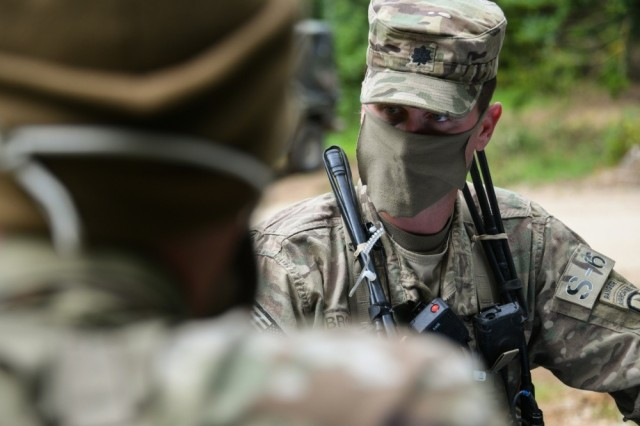 Lt. Col. Joshua Brown, commander of 1st Squadron, 91st Cavalry Regiment, 173rd Airborne Brigade, talks with his Soldiers during a reconnaissance exercise at 7th Army Training Command's Hohenfels Training Area, Germany, June 5, 2020. Despite COVID-19 safety restrictions, Brig. Gen. Christopher Norrie, 7th ATC commander, said Oct. 26, 2020, that the command has not experienced any decline in readiness.