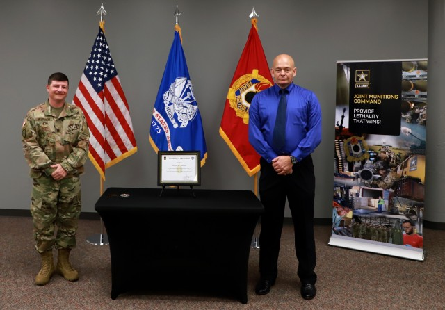 JMC's Command Sgt. Maj. Brian Morrison presents Wayne Tadlock with a certificate of appreciation from Command Sgt. Maj. Anthony Forker for returning the ring in September 2020.