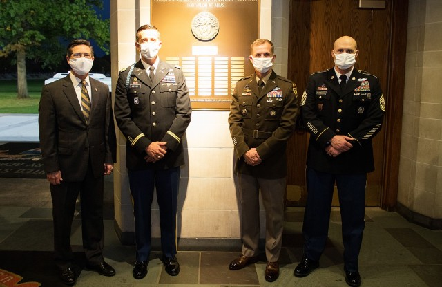 Maj. John A. Meyer (second from left), U.S. Military Academy Class of 2005, stands with the Commandant of Cadets  Brig. Gen. Curtis A. Buzzard (second from right), Association of Graduates President Todd Browne and U.S. Corps of Cadets Command Sgt. Maj. Kenneth Killingsworth Oct. 22 in front of the Alexander R. Nininger plaque.
