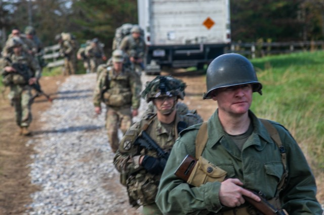U.S. Army Maj. Thomas Bruneau, brigade intelligence officer, 1st Brigade Combat Team, 101st Airborne Division, lead the brigade's leaders to the starting point to initiate the start of Bastogne Forge with a 26-hour tactical training event Oct. 27 in Dahlonega, Ga., during the brigade senior leader professional development exercise. The Bastogne Forge exercise took the leadership within 1BCT, 101st Abn Div. on a five day leader development exercise to strengthen bonds through shared hardship and gain a greater understanding of their unit history.