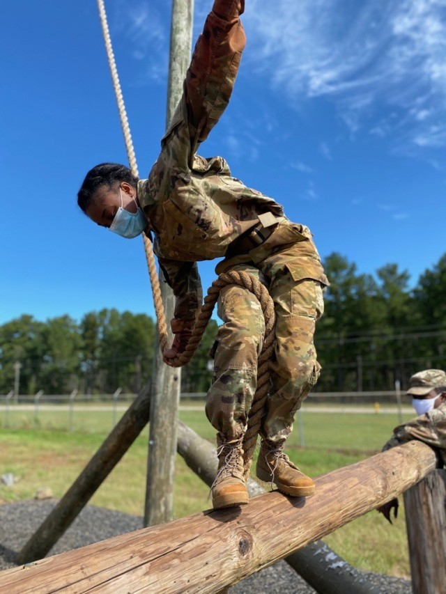 Cadet Shankle maneuvers the Swing Stop Jump obstacle