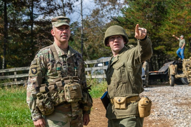 U.S. Army Col. Robert Born, brigade commander, 1st Brigade Combat Team, 101st Airborne Division, left, and U.S. Army Maj. Trent Talley, brigade operations officer, 1st Brigade Combat Team, 101st Airborne Division, right, discuss the initiation of of Bastogne Forge's 26-hour tactical training event and where the senior leaders are expected to begin Oct. 27 in Dahlonega, Ga. during the brigade senior leader professional development exercise. The Bastogne Forge exercise took the leadership within 1BCT, 101st Abn Div. on a five day leader development exercise to strengthen bonds through shared hardship and gain a greater understanding of their unit history.