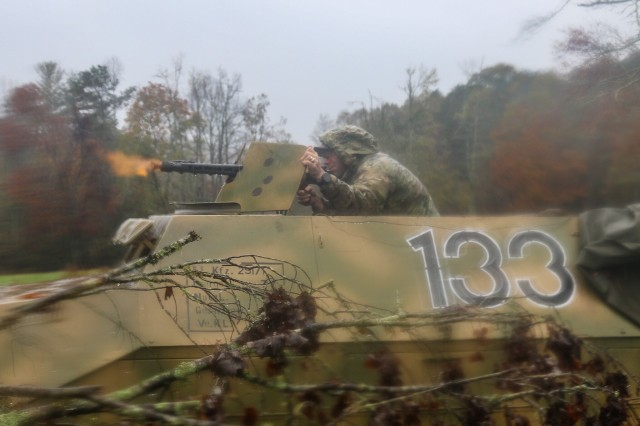 U.S. Army Maj. Trent Talley, brigade operations officer officer, 1st Brigade Combat Team, 101st Airborne Division, firing a MG 34 machine gun from a WWII era halftrack as part of the opposing forces against the brigade's leaders during the 26-hour tactical training portion of Bastogne Forge Oct. 28 in Dahlonega, Ga. The Bastogne Forge exercise took the leadership within 1BCT, 101st Abn Div. on a five day leader development exercise to strengthen bonds through shared hardship and gain a greater understanding of their unit history.