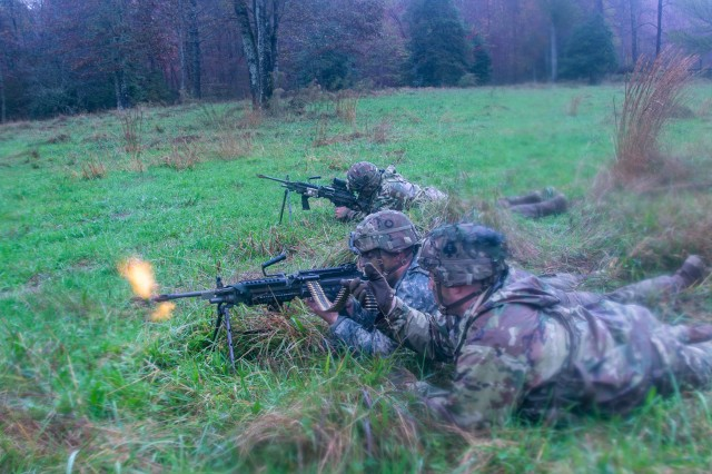 U.S. Army Soldiers from 1st Brigade Combat Team, 101st Airborne Division, firing M240B machine guns from their firing positions at the final assault during the 26-hour tactical training portion of Bastogne Forge Oct. 28 in Dahlonega, Ga. The Bastogne Forge exercise took the leadership within 1BCT, 101st Abn Div. on a five day leader development exercise to strengthen bonds through shared hardship and gain a greater understanding of their unit history.