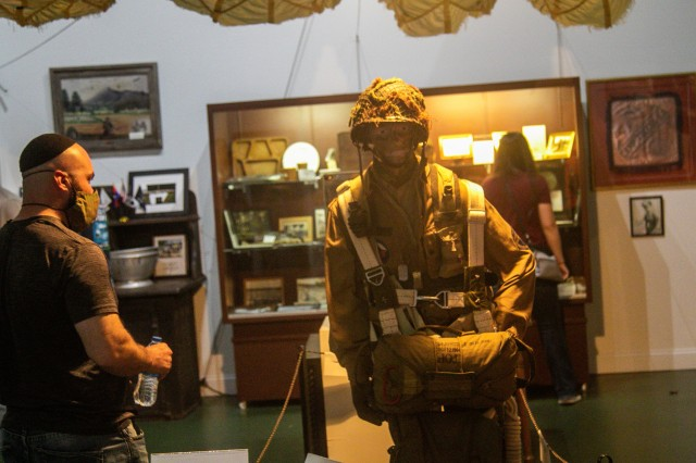U.S. Army 1st Lt. Evan Shields, brigade intelligence collection officer, 1st Brigade Combat Team, 101st Airborne Division, views a replica of a WWII paratrooper at the Currahee Military Museum during Bastogne Forge Oct. 29 in Toccoa, Ga., during the brigade senior leader professional development exercise. The Bastogne Forge exercise took the leadership within 1BCT, 101st Abn Div. on a five day leader development exercise to strengthen bonds through shared hardship and gain a greater understanding of their unit history.