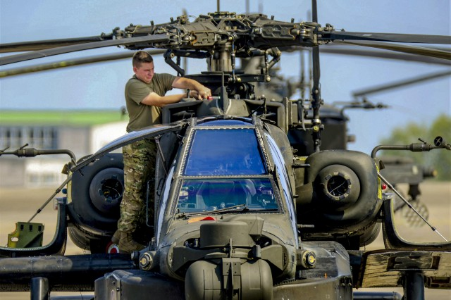 A U.S. Soldier with D Company, 1st Battalion, 3rd Aviation Regiment (Attack Reconnaissance), 12th Combat Aviation Brigade, conducts routine maintenance on a AH-64 Apache helicopter on Aug. 29, 2018, at Katterbach Army Airfield in Ansbach, Germany.