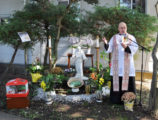 Chaplain (Lt. Col.) Alan Irizarry, operations chaplain for U.S. Army Japan and a Catholic priest, prays for pets and their families in a garden next to Camp Zama Chapel during the Holy Family Catholic Community St. Francis Blessing of the Pets and Animals, Camp Zama, Japan, Oct. 31.
